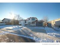 UNIQUE HOME IN REDCLIFF WITH TWO GARAGES LOCATED ON MASSIVE LOT