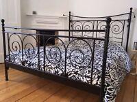 Black metal Ikea bed