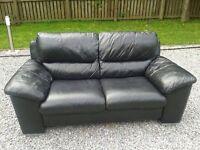 Stunning 2 x black leather 2 seater sofas