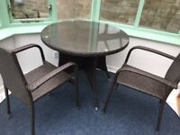 Dark bamboo effect round garden table with glass top and 4 matching chairs excellent condition