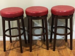 3 wood stools with red seating