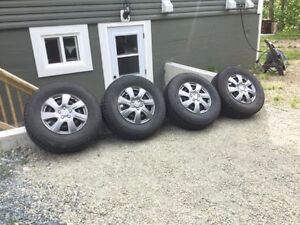 Four Winter Tires with Rims and Hubcaps 265/70/17
