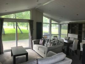 3 BEDROOM LODGE FOR SALE IN NORTH WALES -SITED ON A LAKESIDE PLOT WITH VIEWS OF THE SNOWDONIA RANGE