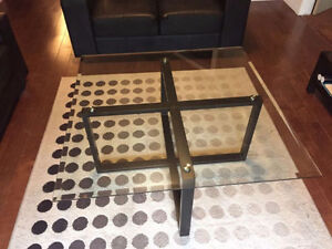 A Fancy glass and metal coffee table , good condition, no chips.