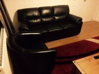 Leather style 3 seater and arm chair looking for a new home....