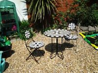 A TILED TOP GARDEN CHAIRS AND TABLE SET.