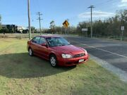 1999 Subaru Liberty MY00 GX (AWD) Red 4 Speed Automatic Sedan Clontarf Redcliffe Area Preview