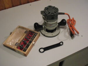 Black and Decker  router, router table,  with  5 bits