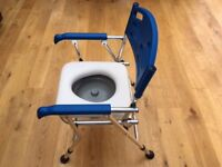 Folding Lightweight Commode in as new condition used once only.