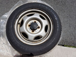 Set of 4 Toyota Corolla rims with tires