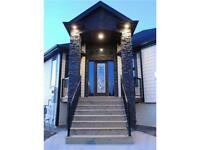 EXTRAORDINARY CUSTOM BUILT BUNGALOW WITH TRIPLE CAR GARAGE!