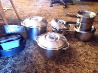 Stainless steel pots and pans with other kitchen utensils.  $25