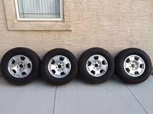 """GM/CHEV 17"""" TRUCK RIMS AND TIRES W/TPMS (2 TIRES ARE NEW)"""