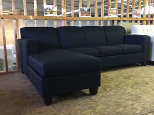 Brand new, modern cozy sectional that comes in a black fabric!
