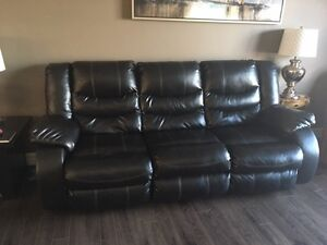 leather couch in perfect condition. reclining