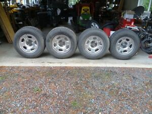 Cooper Discoverer M&S studded truck tires on wheels for sale.