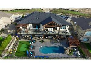 LUXURIOUS RANCHER WALKOUT WITH VIEW, POOL AND LEGAL SUITE!