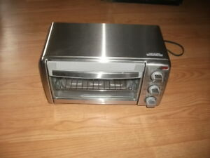 four-toaster Black and decker  Neuf