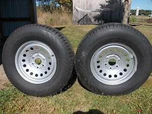 Two (2) Snow tires and Chevy Rims