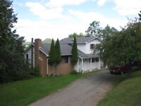 Well-Kept home w/views of Kennebecasis River w/ great garage