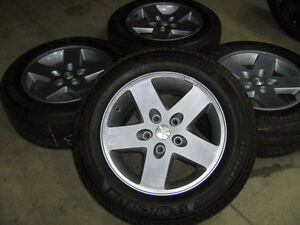 JEEP ALLOY RIMS AND SNOW TIRES