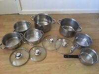 Sets of stainless steel pans including steamer set, stock pots and saucepans