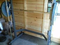 Smiths machine with 2 x 20 kg Olympic weights