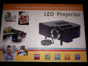 new in box LED projector compacted size 75$
