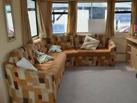 Pre-owned caravan for sale, North Wales with indoor pool. 8.9% finance option available