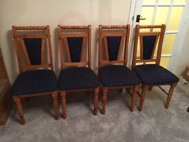 4 dining chairs with blue seat cushions for sale