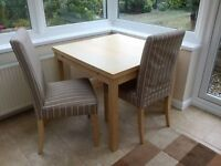 Ikea extendable table and two dining chairs