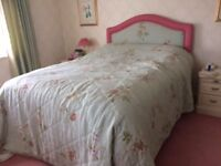 Headboard and bedspread both matching in Designers Guild fabric