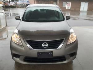 2912 NISSAN VERSA SV SEDAN 5 SPEED,,NEW BODY STYLE..MINT!