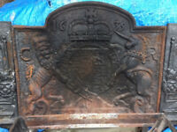 Open fire basket & cast iron fire back with coat of arms and dated 1635. Includes extra side wings