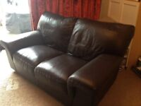 Small brown leather settee/ sofa