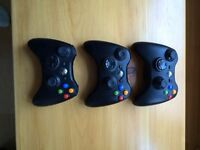 Three Xbox 360 wireless controllers and games for sale