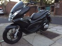 Honda PCX 125 2013 for sale £1550 no offers.