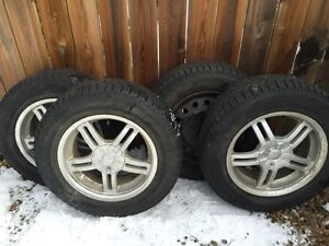"""Michelin X-Ice 16"""" Tires And Rims 245/65R16"""