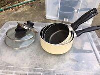 3 saucepans with lids