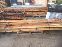Pallet of approx 45 x 3 metre treated wooden timber arris rails - morticed ends