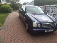 Blue Mercedes E Class, regularly serviced and in good condition.