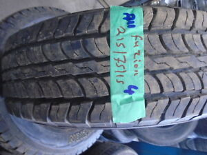 FOUR USED ALL SEASON TIRES  215-75-15 { FUZION } R.H AUTO