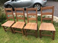 4 solid oak ladder back chairs