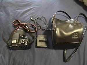Barely used Canon Rebel T5 DSLR w 18-55mm IS lens + case