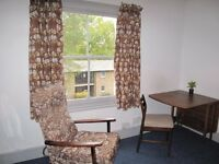 Central clean comfortable single bedsit behind police station . Have own cooking facilities .