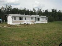 AFFORDABLE COUNTRY LIVING AT ITS BEST ON 7.78 ACRES!