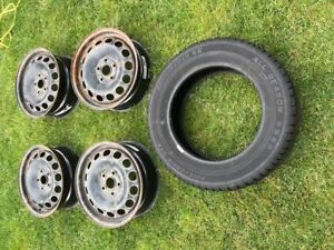 """4 - 16"""" x 6.5"""" steel rims with a 5 x 114.3 bo;t pattern"""