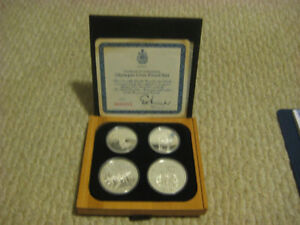 OLYMPIC COIN 'S SILVER SET , COMES WITH BOX FOR SALE