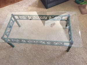 Dark green glass and metal coffee table in perfect condition.