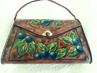 ANTIQUE TOFFEE TIN IN THE SHAPE OF A BAG